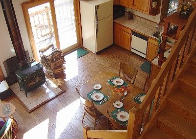 The view of the dining area and kitchen from the loft