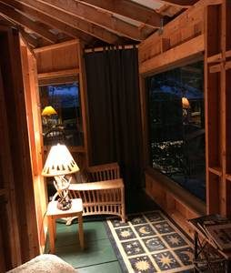 Inside of the magical treehouse at night.